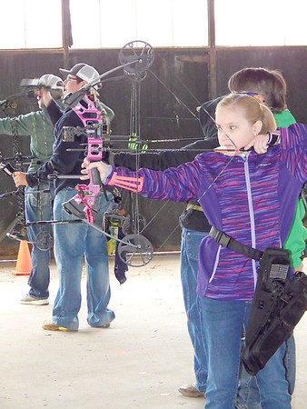 KENTON BROOKS/Muskogee Phoenix<br /> Macie Bess, a 10-year-old from Tecumseh, aims to shoot her arrow during the Muskogee County 4-H Archery Shoot on Saturday. Bess was one of 15 boys and girls who competed in the event.