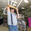 Tim Katowich carries a chair through the Salvation Army Thrift Store to deliver for a customer. He said the Salvation Army helped him as a youth.