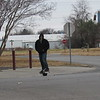 CATHY SPAULDING/Muskogee Phoenix<br /> O'Neal Bunch prepares to cross Park Drive in Spaulding Park on his one-wheeled electric skateboard shortly after lunch on Monday. O'Neal Bunch enjoys wheeling around town on an electric skateboard. He is active in the Facebook forum Muskogee Electric Skateboarding.