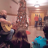 """CHESLEY OXENDINE/Muskogee Phoenix<br /> Musician Billy Arnett plays """"Stones Under Rushing Water"""" for the gathered audience at the Tree of Remembrance ceremony held Tuesday night in the Muskogee County Courthouse. The event was held in memory of murder victims."""