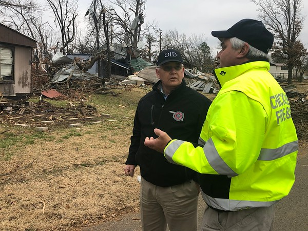 CHESLEY OXENDINE/Muskogee Phoenix<br /> Oklahoma Insurance Commissioner John Doak, left, speaks with Chicken Creek Fire Department volunteer Jesse Sparks while examining the damage done to Chicken Creek homes by a Friday night tornado.