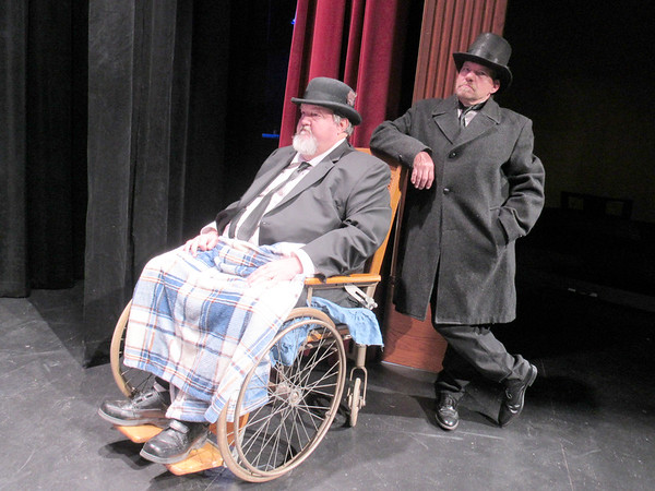 "CATHY SPAULDING/Muskogee Phoenix<br /> Greedy old Henry Potter (Tim Dunn, left) and his goon (Tommy Swearengin) await their chance to wreak havoc on George Bailey's dream in ""It's a Wonderful Life."""
