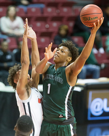 Phoenix special photo by Von Castor<br /> Muskogee's CJ Parks scores in the lane over a Union defender Tuesday night at the UMAC in Tulsa.
