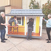 CHESLEY OXENDINE/Muskogee Phoenix<br /> From left, Stacy, Archer and Stockton Hogle, joined by Holly Rosser-Miller, check out a handcrafted playhouse built by Dr. Larry Hamilton for the Third Annual Kids' Space Charity Auction.