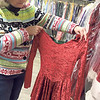 ANDREA CHANCELLOR/Special to the Phoenix<br /> Store owner Debbie Russell examines an Elf outfit.