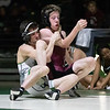 SHANE KEETER/Special to the Phoenix<br /> Willliam Caraway battles Aiden Garriott of Jenks at 120 pounds. Caraway won the match for Muskogee, but the Roughers lost.