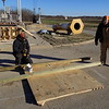"Staff photo by Mike Elswick<br /> Orie Chambers, left, and his father Steve Chambers, both with KBC<br /> Construction of Broken Arrow, prepare a crane pad on Thursday. The project will include the installation of a hoist and ""basket screen"" designed to protect the pumps, two of which were damaged in May by debris carried through a 72-inch pipe during an extreme weather event."