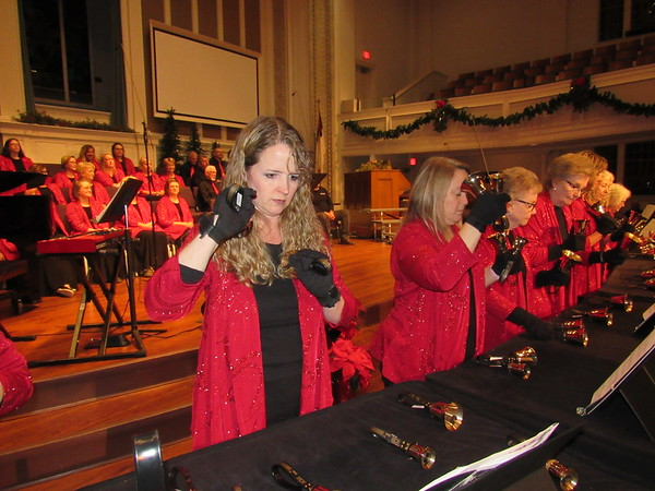 "Staff photo by Cathy Spaulding Joy Nelson rings hand bells with the Joyful Ringers during a dress rehearsal for ""A First Muskogee Christmas,"" which will be performed Sunday at First Baptist Church."