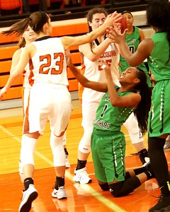Phoenix special photo by John Hasler Muskogee's D'India Brown goes to the floor and is pressured by Tahlequah's Sierra L. Smith, left, in a loose ball scramble in the Tahlequah Invitational.