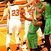 Phoenix special photo by John Hasler<br /> Muskogee's D'India Brown goes to the floor and is pressured by Tahlequah's Sierra L. Smith, left, in a loose ball scramble in the Tahlequah Invitational.