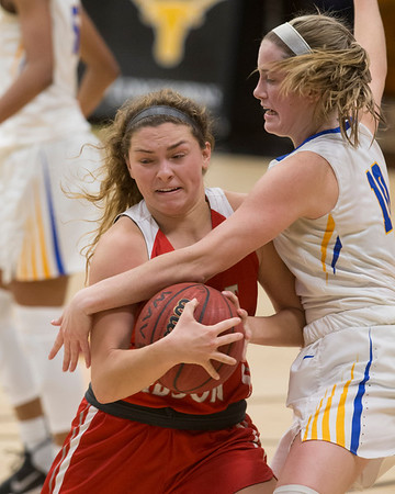 VON CASTOR/Special to the Phoenix Fort Gibson's Mallory Baker is fouled by Victory Christians Bella Wakly as she drives the lane in the finals of the Inola Tournament Friday night.