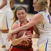 VON CASTOR/Special to the Phoenix<br /> Fort Gibson's Mallory Baker is fouled by Victory Christians Bella Wakly as she drives the lane in the finals of the Inola Tournament Friday night.