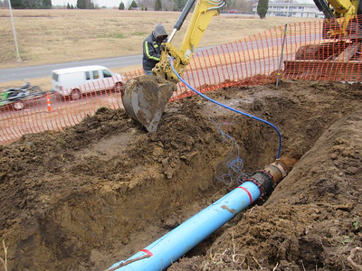 CATHY SPAULDING/Muskogee Phoenix David Springer of the Muskogee Water Department flushes water out of a replaced water line at the Centennial Trail overpass over U.S. 69. Superintendent Danny Gable said a 12-inch water line busted around 7 p.m. Thursday. Gable said crews flushed the line on Friday afternoon and replaced the line by Friday evening. Crews also replaced a 6-inch line on Elgin Street.