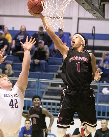 Phoenix special photo by Shane Keeter<br /> Wagoner's Ashton Bartholomew attempts a shot in the first quarter of the J.T. Dixon Memorial boys semifinal.