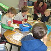 Staff photo by Cathy Spaulding<br /> State Superintendent of Public Instruction Joy Hofmeister watches  Warner Elementary student FredrickBrewer do his work. Hofmeister visited Warner Schools on Friday to see how they accomplished high standardized test scores.