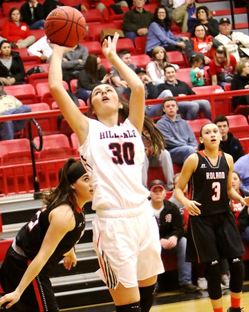 Phoenix special photo by John Hasler<br /> Hilldale's Peyton Gaddy drives in for two points during the Lady Hornets' 62-45 loss to Roland on Friday in the semifinals of the Hilldale Tournament.