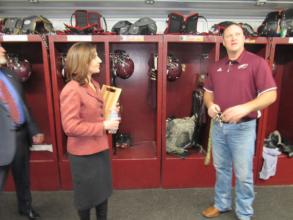 Staff photo by Cathy Spaulding<br /> State Superintendent of Public Instruction Joy Hofmeister listens as Warner High School Principal Jeremy Jackson tells how construction students built the football lockers. Hofmeister visited Warner Schools on Friday.