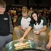 Staff photo by Cathy Spaulding<br /> Oktaha sixth-graders Peyton Capps, left, and Wesley Reganall, right, watch Sarah McCarty, second left, and Makenna Juntti load their boat with weights. Capps and Reganall competed in the 10th annual Math and Engineering Competition.