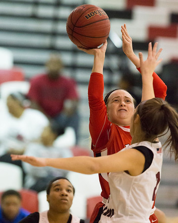 Phoenix special photo by Von Castor<br /> Fort Gibson's Kabree Edgmon shoots over Wagoner's Kaitlyn Bruce Friday night at Wagoner. The Lady Tigers beat the Lady Bulldogs 62-21.