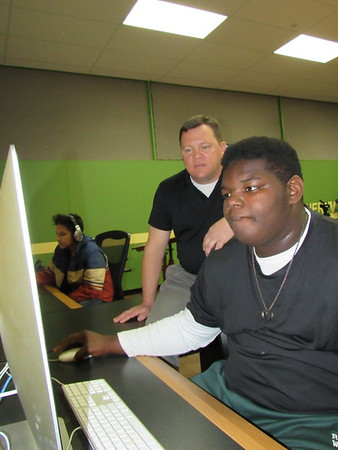 Staff photo by Cathy Spaulding<br /> Muskogee High School video and production teacher Shane Stewart, left, goes over a video assignment with MHS student Micheal Buckhanan.