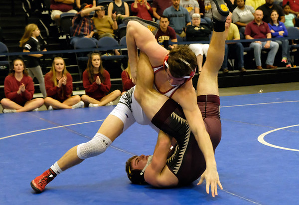 Special photo by Justin Lauffer<br /> Wagoner's Trey Ivey fights off Clinton's Grayson Weeden, who Ivey defeated in the 152-pound match during the Class 4A dusl state semifinals on Saturday at Firelake Arena in Shawnee. Wagoner lost, 35-26.