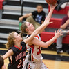 Phoenix special photo by Von Castor<br /> Hilldale's Kenzie Mize, right, drives past Locust Grove's Regan Torry for two of her 20 points at the Hilldale Event Center on Friday. The Lady Hornets beat the Lady Pirates 62-42.
