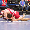 Phoenix special photo by Samuel Perry<br /> Fort Gibson's Justin Cates, top, gets McLoud's Jesse Lambert in position for the pin, which came at the 5:54 mark at 182 pounds during Friday's Class 4A quarterfinals of the state dual tournament at Firelake Arena at Shawnee. The Tigers beat the Redskins 57-18 and will face No. 4 Cushing at noon today in the semifinals.