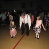 "Staff photo by Cathy Spaulding<br /> Justin Kinman gets into a ""Cha Cha Slide"" with his 4-year-old daughter Lili, left, and his 7-year-old daughter Emma. The three slid, cha-cha'ed and Chicken Danced at the American Legion Father Daughter Dance."