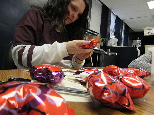 Staff photo by Cathy Spaulding<br /> Oklahoma School for the Blind sophomore Malerie Levens of Owasso puts inflated Valentines on sticks, to be inserted into cards made by classmates. Service learning students created 40 Valentine cards and packets to be distributed today at the Jack C. Montgomery VA Medical Center. The packets featured bags of candy. Some packets had sugar-free candy. Greetings were printed in Braille, as well as with magic marker and pens.