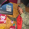 Staff photo by Cathy Spaulding<br /> Alice Robertson Junior High seventh-grader My'unique Jolly smooths the edges of a Valentine she helped place on the Alice Robertson Home on Tuesday. The effort was a Heart Bomb, promoted by the National Trust for Historic Preservation.