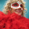 "Staff photo by Cathy Spaulding<br /> Lacy Page dons floozy-like feathers for her role in the ""Murder at the Mardi Gras"" mystery. Muskogee Public Library will present the mystery Saturday for a matinee and a dinner."