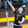 Phoenix special photo by Von Castor<br /> Okay's Caleb Riggs shoots in front of Porum's Zach Scheuler Thursday night in the Class A regional at Porum. Okay won to advance to Saturday's regional finals.