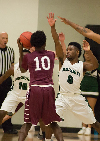 Phoenix special photo by Abigail Washington<br /> Muskogee's Travon Hughes, right, applies the defense along with teammate Chris Mims against Jenks in the home finale at Ron Milam Gym.