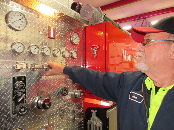 Staff photo by Cathy Spaulding<br /> Mountain View Fire Chief Don Dailey checks gauges on a fire truck. Dailey was one of the original members of the volunteer fire department.