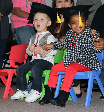 Special photo by Travis Sloat<br /> Children First program graduates Wesley Clinton (left), and Israel Jones, happily await the presentation of the diplomas on Friday. The toddlers and their parents were part of a Muskogee County Health Department service that provides assistance to first time mothers and their children.