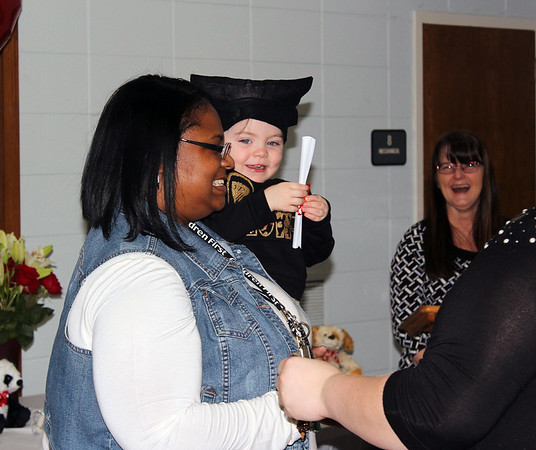 Photo by Travis Sloat<br /> Graduate Ellamay Shoemake was all smiles as she ran immediately to Nichelle Gaines after the ceremony.