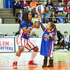 Special photo by Mandy Lundy<br /> Harlem Globetrotter TNT helps 5-year-old Alyssa Turner spin the ball on her finger. The Globetrotters brought their 2017 world tour to town Wednesday for an game at the Muskogee Civic Center.