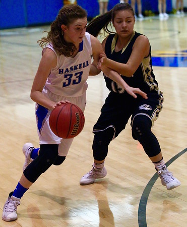 Special photo by Darren Stephens<br /> Haskell's Kristen Webb, left, drives into the circle in Friday's playoff game.