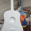 Staff photo by Cathy Spaulding<br /> An unpainted art guitar stands by a guitar painted by artist Gwyn LaCrone at the Muskogee Art Guild. LaCrone's guitar will be displayed at the dentist office of Dr. Michael Stephens.