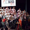Special photo by Wendy Burton<br /> People from dozens of churches and a variety of denominations worship on stage at the One Blood Revival on Tuesday at the Muskogee Civic Center.