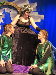 "Staff photo by Cathy Spaulding Ursula the sea witch, (Sara Smythe, center) hears a report from her eelish minions Flotsam (Jasmine Speer, left) and Jetsam (Hannah Webster) in the Muskogee High School production of Disney's ""The Little Mermaid."""