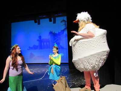 "Staff photo by Cathy Spaulding Ariel, the mermaid (Madison Eckerson, left,) and her Flounder friend (Marissa Smith, center) strike a deal with Scuttle, the seagull (Haley Wayerski) in the Muskogee Little Theatre production of Disney's ""The Little Mermaid."""