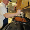 Staff photo by Cathy Spaulding<br /> Kiwanis member T.J. Ellis stirs chili to be served at Wednesday's Chili Day. This is the fourth year Muskogee County Lions Club and the Kiwanis Club of Muskogee joined in Chili Day, a fundraiser. It was held at the Bedouin Shrine Temple. Proceeds from the chili lunches benefit Oklahoma School for the Blind, the 4-H Club and Junior Achievement.