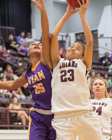 Phoenix special photo by Shane Keeter<br /> Vian's Dia Jackson, left, and Sequoyah's Kymber Tyon battle for the ball on Thursday in the Class 3A Wilburton Regional game at Sequoyah.