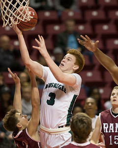 Phoenix special photo by Von Castor Muskogee's Brooks Haddock shoots in the lane against Owasso in Friday's Class 6A boys regional game in Tulsa. The Roughers lost 65-60.