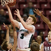 Phoenix special photo by Von Castor<br /> Muskogee's Brooks Haddock shoots in the lane against Owasso in Friday's Class 6A boys regional game in Tulsa. The Roughers lost 65-60.