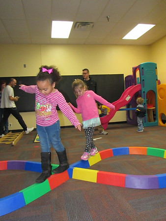 Staff photo by Cathy Spaulding<br /> Early Childhood Center students Mycah Daniels, left, and Anna Gipson master a figure eight on a balance beam at school's Action Based Learning Lab.