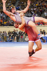 Phoenix special photo by Samuel Perry Fort Gibson's Justin Cates picks up Luke Fortney of Bristow on his way to a 9-3 decision in the Class 4A 182-pound semifinals of the state wrestling tournament in Oklahoma City. Cates will wrestle Drake Barbee of Stilwell in today's final.