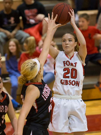 Phoenix special photo by Von Castor Fort Gibson's Ali Christie looks to pass over a Locust Grove defender during Saturday's Class 4A Fort Gibson Regional championship game at Harrison Field House, won by the Lady Tigers 69-26.