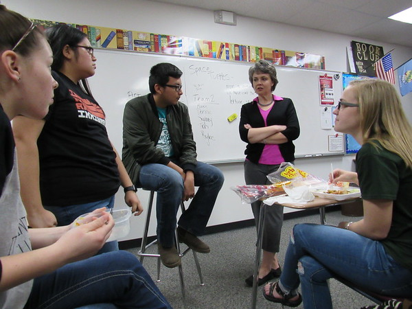 Photo by Cathy Spaulding<br /> Members of Fort Gibson High School's Book Club, from left, Zoe Shieldnight, Maria Hernandez, Eric Macarena and, right, Reana Nichols, talk with club sponsor Cassandra Edwards. Club members are planning books for the elementary level library.